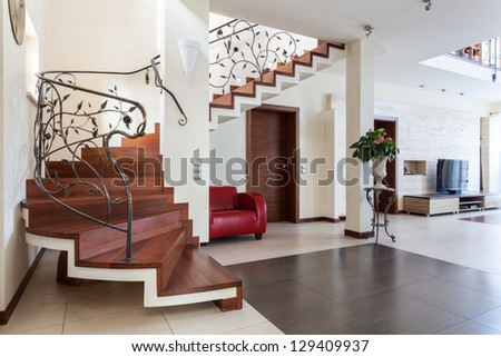 Classy house - living room interior with classic staircase - stock photo