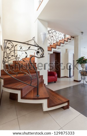 Classy house - metal design stairs leading to living room - stock photo