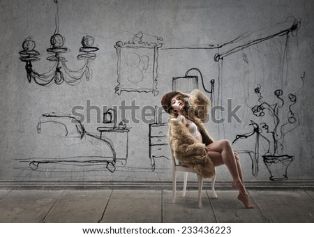 Classy woman in her room  - stock photo