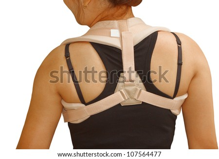 clavicle brace ,clavicle support for fracture clavicle ,woman wearing clavicle brace for release pain and immobilize shoulder - stock photo