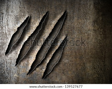 claws scratches marks on rusty metal plate - stock photo