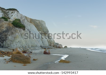Clay Cliffs on a Sandy Beach - stock photo