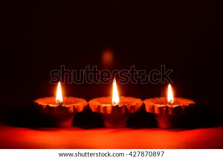 Clay diya lamps lit during festival Celebration. Greetings Card Design Indian Hindu Light Festival called Diwali - stock photo