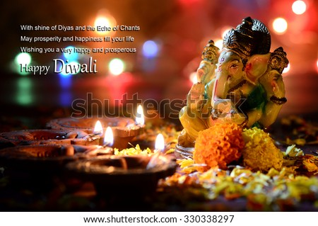 Clay diya lamps lit with Lord Ganesha during Diwali Celebration. Greetings Card Design Indian Hindu Light Festival called Diwali  - stock photo