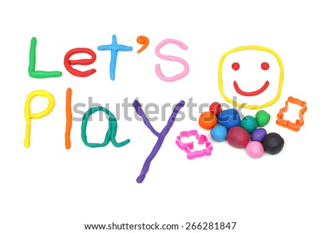 clay for children on isolated background saying let's play - stock photo