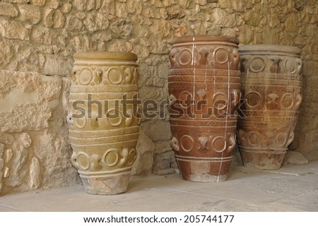 Clay jars at the Palace of Knossos, Crete, Greece. Knossos Palace is the largest Bronze Age archaeological site on Crete and is considered Europe's oldest city, - stock photo
