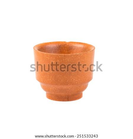 Clay mug isolated on white background - stock photo