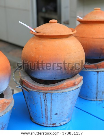 Clay pot for cook and stove - stock photo