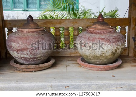 Clay pot on drinking water is the Thai way of life. - stock photo