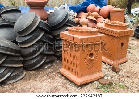 Clay pots. Rustic handmade ceramic clay brown terracotta cups at street handicraft market - stock photo