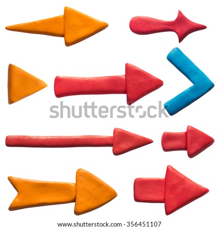 Clay putty, plasticine handmade dimensional arrow icons set. Putty design different shapes arrows isolated on white background. - stock photo