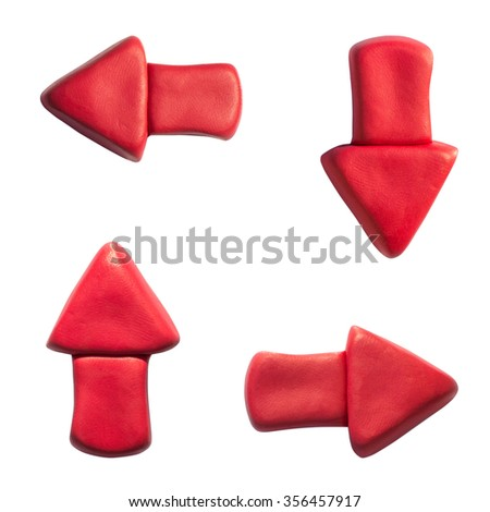 Clay putty, plasticine handmade dimensional arrow icons set. Putty design small red different directions arrows isolated on white background. - stock photo