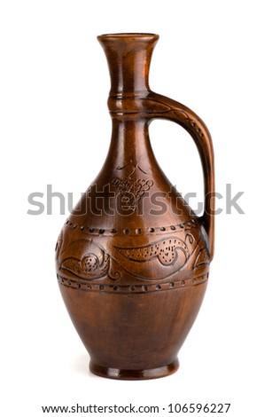 Clay wine jug isolated on white - stock photo