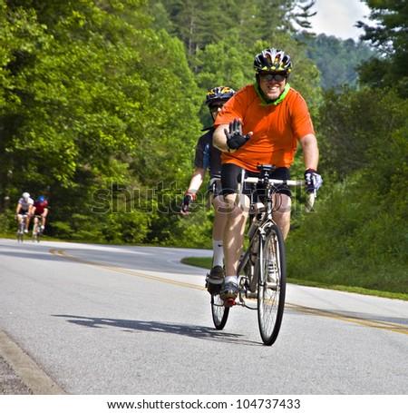 CLAYTON, GA/USA - JUNE 9 : Unidentified cyclist participates in the annual Bicycle Ride Across Georgia, June 9, 2012, in the Lake Burton area of Rabun County, Clayton, GA. - stock photo
