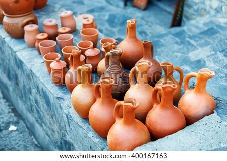 clayware souvenirs sold on a local market in the old town of Sheki, Azerbaijan on Karavan Saray street - stock photo