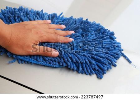 Clean a car by microfiber cloth - stock photo