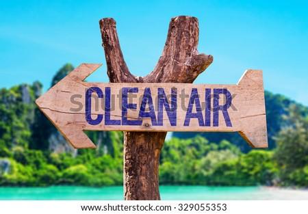 Clean Air arrow with beach background - stock photo