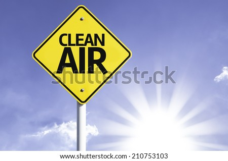 Clean Air road sign with sun background  - stock photo