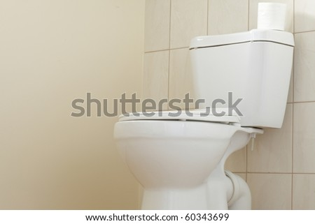 Clean and white toilet in a bathroom - stock photo
