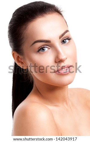 Clean beauty shot of a young woman isolated on white background - stock photo