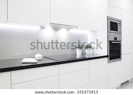 Clean black wheat with decoration in small white kitchen - stock photo
