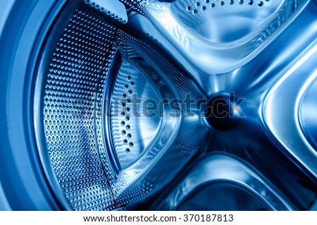 Clean blue light inside the washing machine - extreme detail useful file for repairing services, self-service laundry - stock photo