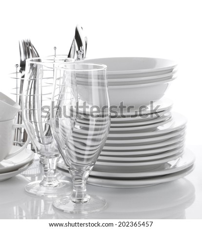 Clean dishes isolated on white - stock photo