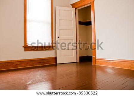 Clean empty room in an vacant old house - stock photo