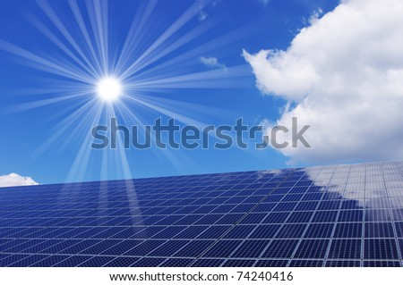 Clean energy generating solar panel and sun. - stock photo