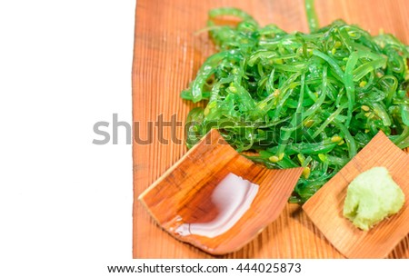 Clean food and good taste with fresh seaweed salad ,japanese food put on beautiful plate isolated on white background in the japan restaurant with copy space,Focus on top of seaweed salad - stock photo