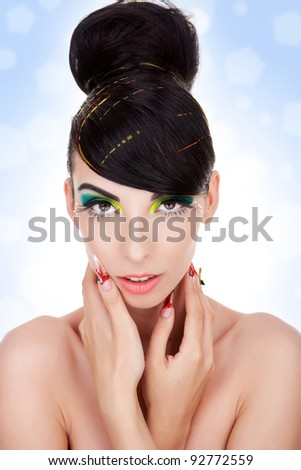 Clean image of a beautiful young woman . Beauty and health, cosmetics and make-up. Portrait of fashion woman model with bright yellow & green make-up, nice hairstyle - stock photo