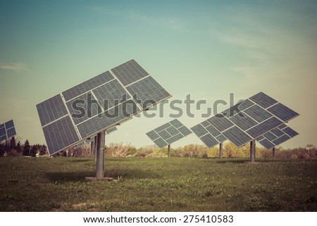 Clean image of commercial Solar plant on a prairie generating clean electric power - stock photo