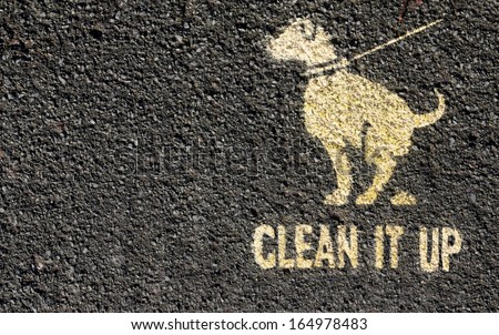 Clean it up sign printed on a path. - stock photo