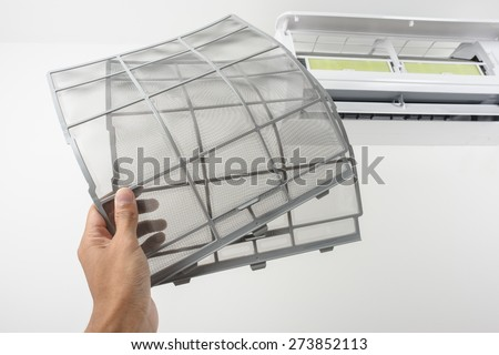 clean stainless air filter for wall type air conditioner - stock photo