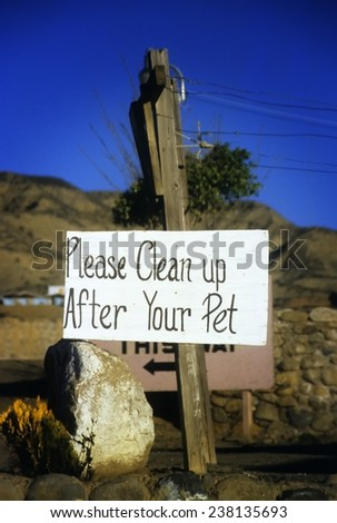 Clean up after your pet sign in the Baja California desert - stock photo