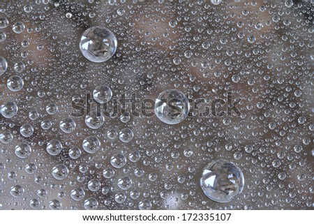 Clean water drops background on glass surface  - stock photo