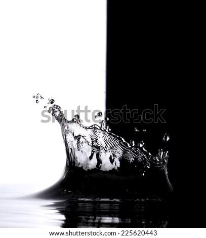 clean water splash on black background - stock photo
