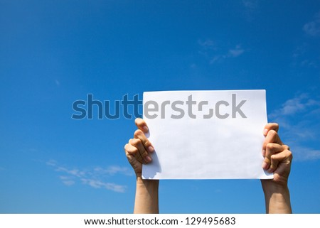 Clean white sheet paper over the sky. - stock photo