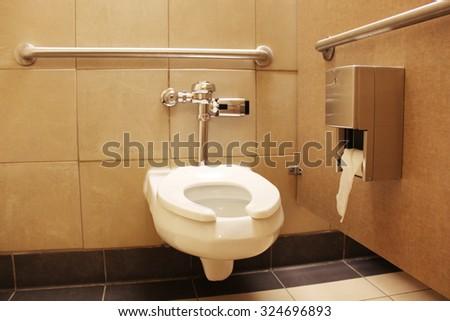 Clean white toilet stall - stock photo
