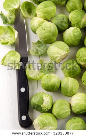 cleaned brussels sprout and kitchen knife - stock photo
