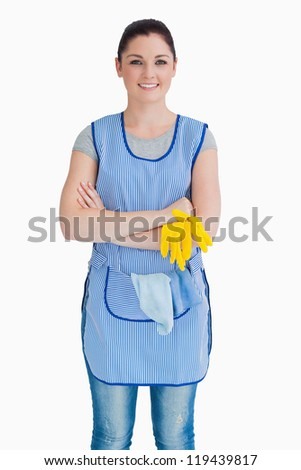 Cleaner crossing her arms on the white background - stock photo