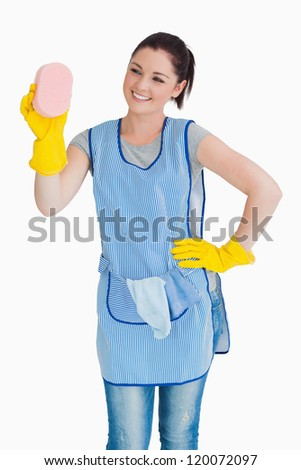 Cleaner woman washing with a sponge on the white background - stock photo