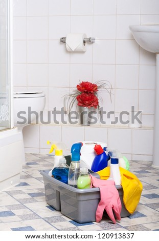 Cleaning Bathroom Kitchen cleaner washing room wipe tiles   - stock photo