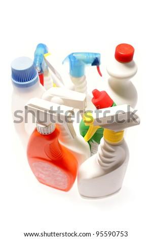 Cleaning bottles on plain background - stock photo