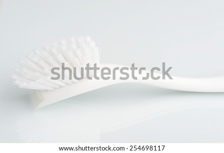 Cleaning brush on white background - stock photo