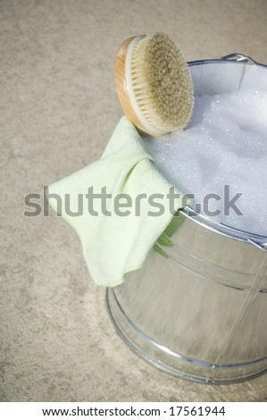 Cleaning cloth in bucket of soapy water - stock photo