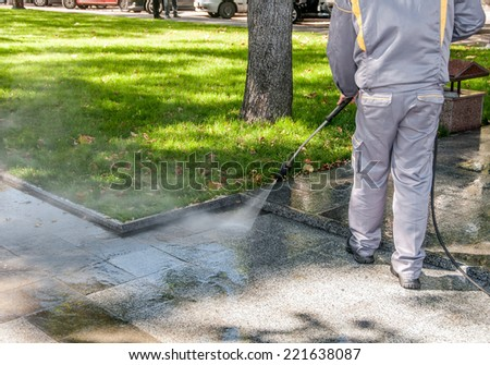 cleaning dirty streets with high pressure cleaner - stock photo