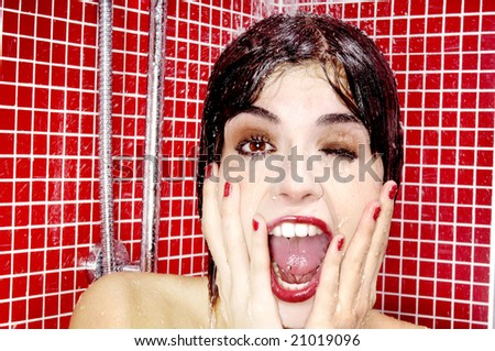 Cleaning face under shower - stock photo