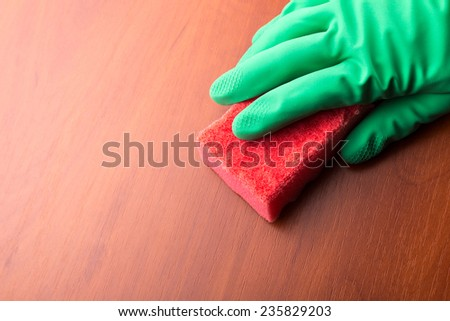 Cleaning glove with a sponge. Closeup - stock photo
