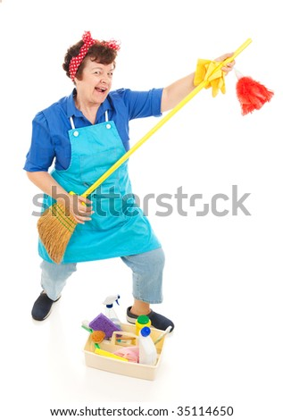 Cleaning lady takes a break to have some fun playing air guitar on her broom.  Full body isolated. - stock photo